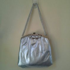 "Silver Evening Bag Silver foil fabric outer with silver hardware. Snap closure at top. Adjustable chain handle - from a short drop of 7"" to a longer drop of 12"". Nude satin lining. Lining is perfectly clean. Outside has a couple of very, very light marks, but I have not been able to capture them (sorry!!!). Excellent condition, overall. No brand/label. Bags"