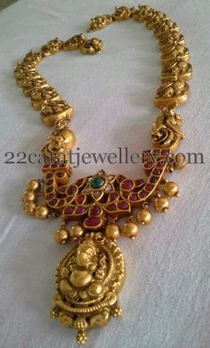 Jewellery Designs: Temple Long Chain with Ganesh Ruby Locket