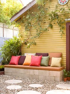 Budget-Friendly Bench  A clever concrete block bench for only $30. Scrap fabric covers the pillows and the plank that top off this truly brilliant seating area.