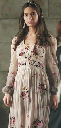 Kenna in white multicolored floral dress.