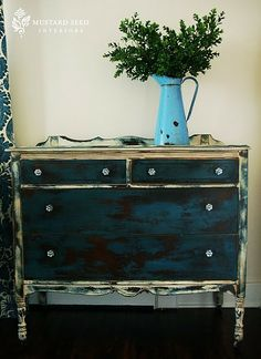 Paint edges of black /indigo furniture to break it up and incorporate accent colors