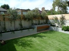 Small garden design travertine paving artificial easi grass fake lawn raised block render walls in grey hardwood screen flaoting bench bespoke shed Dulwich Balham Clapham Battersea Fulham Chelsea London Contact anewgarden for more information
