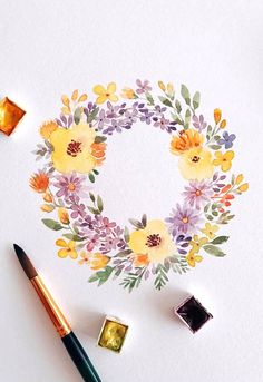 Watercolor floral wreath painting by ig@wkndiminlove.