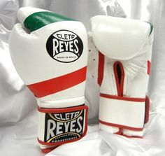 Cleto Reyes Hook & Loop Training Gloves - Velcro - Mexican Flag (16oz) by Cleto Reyes. $179.99. The best sleek and contoured design. Manufactured with the highest quality leather. Nylon water repellent lining offers excellent protection against sweat entering the padding. New style boxing gloves without laces with a leather wrap around wrist and an extra long cuff for greater wrist protection. Attached thumbs protects eyes and helps prevent thumbs from being sprained or broken...