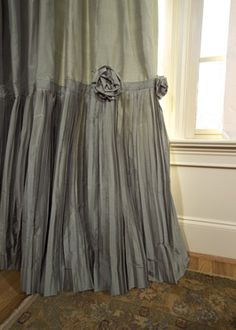Romantic Rosettes - your eye is drawn [or line of vision] to the bottom of the side panel, using a crinkle pleated fabric as a contrast skirt.  A couple of fabric rosettes add that extra designer touch.""