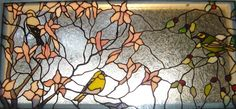Stained Glass Goldfinches in the magnolia with hooded warbler.