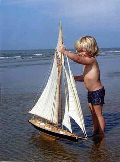 Wonder if Dad knows he's playing with his fab model sailboat??