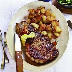 Grilled Ribeye Steaks with Roasted Rosemary Potatoes // More Delicious Steak Recipes: http://www.foodandwine.com/slideshows/steak #foodandwine