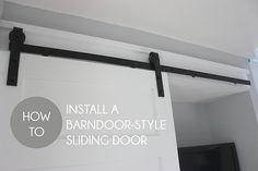 Learn how to hang a barndoor-style sliding door in 7 easy steps!