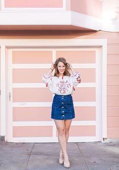Blogger Bella Bucchiotti of xoxoBella.com shares a yellow Chicwish embroidered top and denim skirt in San Francisco.