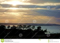 Sun Rays Shining Through Clouds On Lake Wilson Stock Image - Image of reflecting, bright: 104112003 Sun Rays, Clouds, Sky, Water, Image, Heaven, Gripe Water, Heavens, Cloud