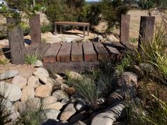 love the dry creek bed idea and rustic elements like the wooden bridge Pond Bridge, Garden Bridge, Garden Paths, Garden Beds, Garden Planters, Australian Native Garden, Sunken Garden, Dry Creek, Cool Pools
