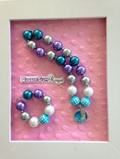 Princess Elsa inspired bubblegum bead necklace with teal, white, purple and silver beads with an Elsa pendant $20 + p&h. Matching bracelet $5 with necklace purchase.