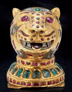 Finial in the form of a Tiger's Head from the throne of Tipu Sultan Mysore (Seringapatam), made between Gold sheet over a natural resin core, set with rubies, diamonds and emeralds. Royal Jewels, Crown Jewels, Ethnic Jewelry, Indian Jewelry, Gold Jewellery, Ancient Jewelry, Antique Jewelry, Gold Sheets, Recent Discoveries