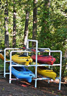 When we moved to our (somewhat) creek front duplex home, my husband, Phil, declared we could kayak from the backyard. Looking suspiciously at the overgrown poison ivy vines by the river edge and th… Canoe Storage, Outdoor Storage, Canoe And Kayak, Kayak Fishing, Kayak Trailer, Kayak Rack, Lakeside Living, Lake Cabins, Go Outdoors