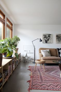 Hemma hos nina, palle & mila. Modern furniture and a beautiful Sumak Carpet.