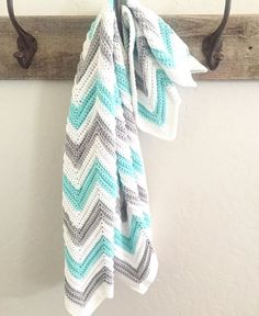 This is a free pattern for a Single Crochet Chevron Blanket in Mint, Gray, and White. It's really a simple pattern, but making a chevron can be so difficult at first! It was for me, and I know for a lot of others because I read your emails and respond as best I can with as much help I can give. For some reason, that chevron pattern gives us all fits and demands a practice swatch and a lot of patience.