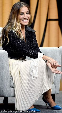 Monochrome magic: The fashionista, who now has her own SJP shoe line, looked beautiful in a black crocheted jacket and a white dress with long lace cuffs and pressed pleats in the skirt