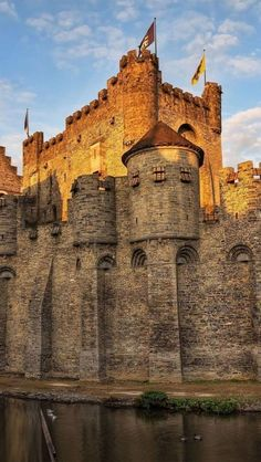 High, empty walls make this castle tower of its medieval moat.  Gravensteen Castle in Ghent, Belgium appears to have been a fortification that was built to withstand pretty massive attacks.