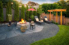 Beautiful fire pit idea and landscaping design.