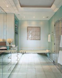 The master bathroom of L'Wren Scott was designed around original Art Deco Lalique elements, including a plaque above the tub depicting leaping koi.
