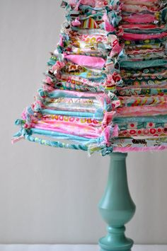 Super cute DIY take old lamp shade cut off old fabric and start tying.