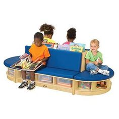 "Read-A-Round Couch - Includes a double-sided couch with slots for ample book storage and two semi-circle benches to form a beautiful and practical literacy center. Seat height is 11 inches. Includes vinyl cushions, 6 tubs and 4 cubbie trays. 36""W x 79""L x 23-1/2""H."