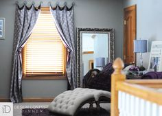 A hexagon-patterned drapery acts as modernized swaged panels over the drapery hardware.  #BudgetBlinds