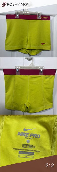 Nike Pro Spandex Shorts Women's Nike Pros. Hot pink and neon yellow. No piling and only worn once! Nike Shorts