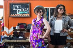Kyla Embrey and Sarah Azzouzi standing outside Lost Girls Vintage fashion truck