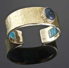 Cuff | Charles Loloma.  18k gold set with Lander turquoise and has Charles's signature inner inlay (Lone Mountain turquoise and lapis.)