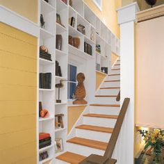 This shelving fits between the 2x4 studs - perfect for the back stairs . . .