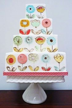 How cute!!! Maybe only use the flower design on one tier and make the cake a garden theme. Love!