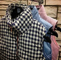 I want this navy check vest with a small pink pointed monogram on the back of the popped collar.