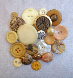 I see some beautiful pieces of jewelry in this group of buttons!