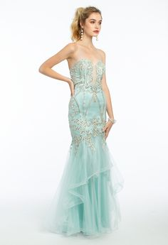 Maintain a powerful presence in this lavish long prom dress! With its sweetheart neckline, fitted embroidered plunging bodice, tiered tulle mermaid skirt and open back, the ornate detailing and elaborate style make this choice fit for a queen...prom queen, that is! For a regal finish, add on metallic heels and a pleat glitter flap clutch. #CamilleLaVie