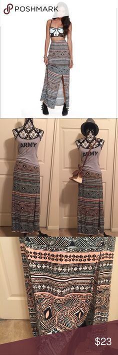 Kendall & Kylie This colorful tribal printed maxi skirt has front side slits and a comfortable elastic waistband. Pair this with a cropped top and ankle boots for a festival-ready look this summer. Used but no rips or stains. Kendall & Kylie Skirts Maxi