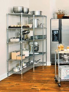 Cabinets that Store More Stainless steel baking shelves is an inexpensive addition that still looks polished and professional.Stainless steel baking shelves is an inexpensive addition that still looks polished and professional. Bakery Kitchen, Home Bakery, Restaurant Kitchen, Kitchen Corner, Kitchen Pantry, New Kitchen, Corner Pantry, Cozy Kitchen, Kitchen Ideas