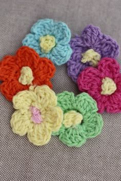 Some Sweet Summer Blooms - 75% off at The Plaid Barn.  You'll receive 6 medium-sized crochet flowers each measuring approx. 1″:     1 – Festive Fuschia with yellow center   1 – Pretty Purple with yellow center  1 – Lemon with pink center  1 – Juicy Orange with yellow center  1 – Baby Blue with yellow center  1 – Grass Green with yellow center  Limit of 15 sets per order.