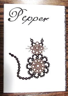 """Pepper       This card was done for my sisters cat, Pepper, a Maine Coon.  She was a rescue animal, that filled our lives.  She had a rare, non-aggressive form of cancer.  Unfortunately, this was extremely aggressive in her.  We will all miss her and cherish the memories.   The pattern was """"Nancy's Christmas Cat"""", by Tat's All.  The thread was Lizbeth, size 20, mocha brown med and fudge dark."""