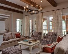 """Family Room Curtain Panels - like this curtain hanging method for """"faking"""" one large window where there is more likely several, or a set of doors -"""