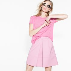 J.Crew Looks We Love: Women's Super Mona Ferragosto sunglasses, Collection featherweight cashmere pocket tee, pleat-front mini skirt, and Abbot metallic slides.