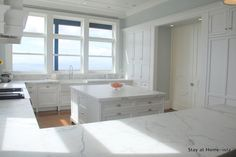 @Jessica Stay At Home-ista is one lucky duckling with her dreamy white marble kitchen. You must see her wall of built in cabinets and her organized drawers.