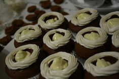 moist, rich gingerbread spiced cupcakes (made with butter, extra yolk, hot milk); filled with from scratch creamy eggnog creme brulee filling; topped with an eggnog american buttercream; topped with nutmeg whipped cream