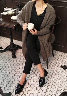 Style!. Paris. Coffee. Long cardigan in a taupe color. Black shirt. Black slacks. Loafers.