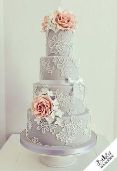 Grey and vintage rose lace wedding cake: Bella's Bakery, facebook