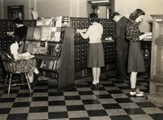 """""""A photo of the [University of Arkansas] library's old card catalog area, taken by Professor Walter J. Lemke while his journalism class was studying there in 1942 (Image Collection 1402)."""""""