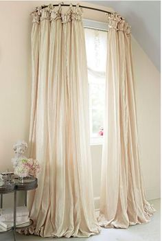 It's called balloon drapery and it will make any living room look just GRAND.