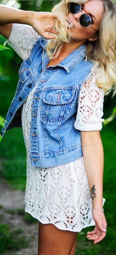 Perfect sleeveless denim over a white lace sundress.