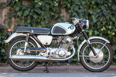 This 1962 Honda CB77 Super Hawk is a second year example of the bike widely credited as the company's first truly sporting offering. Despite the 77 nomenclature, power came from a 305cc, OHC parallel twin capable of 28 HP and 9,000 RPM. Performance was on par with similarly configured but larger-engined British bikes of the era, with the added benefit of better build quality and reliability.